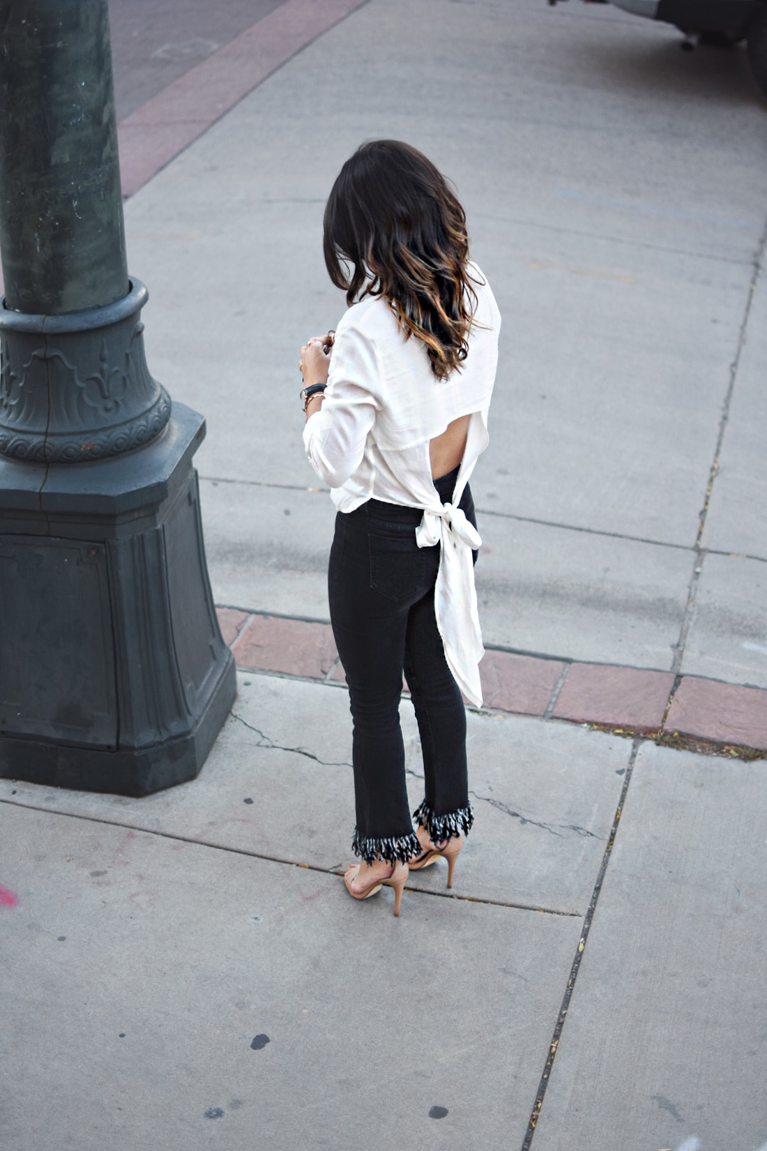 Carolina Hellal of Chic Talk wearing Dezzal frayed jeans, a Chicwish open back top and Steve Madden nude strap jeans