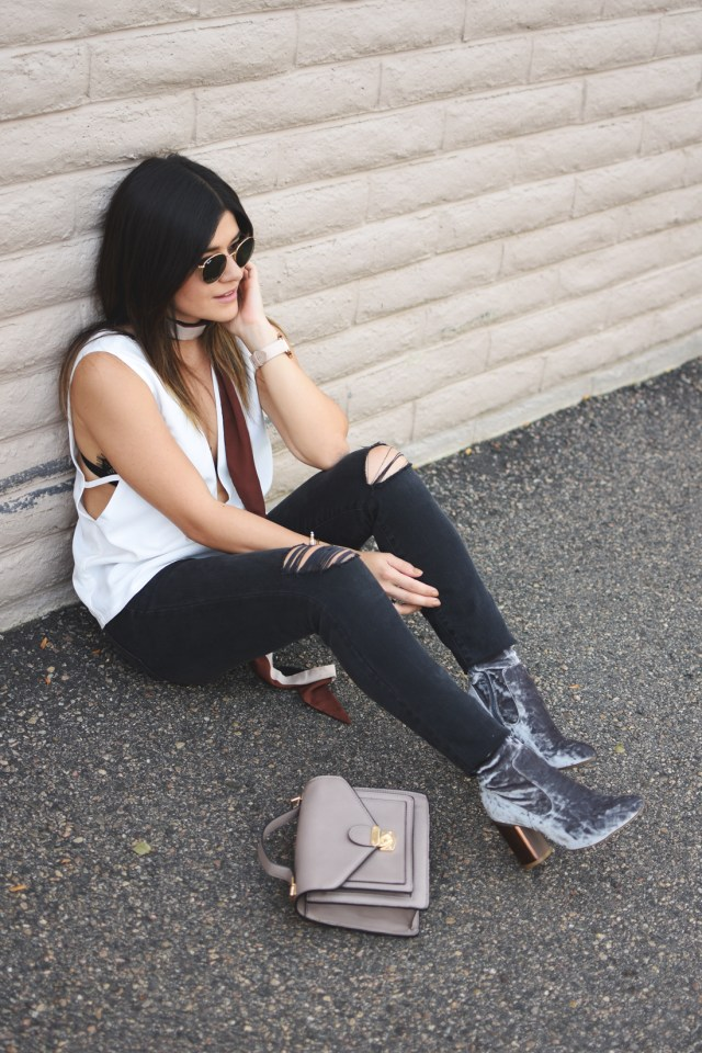 Carolina Hellal of Chic Talk wearing a Tobi white top, Madewell ripped jeans, Public Desire velvet boots and H&M scarf