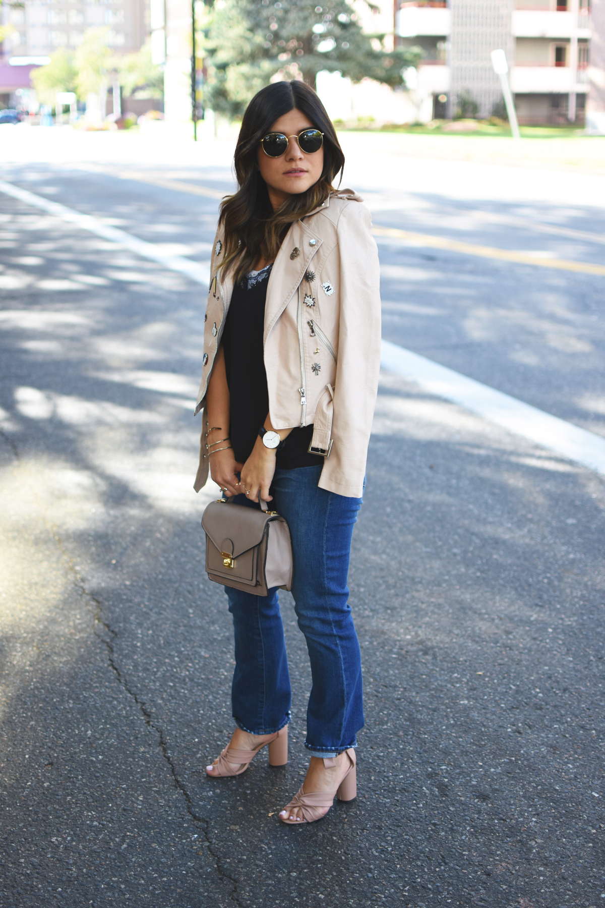Carolina Hellal of Chic Talk wearing a Dezzal blush faux leather jacket, Forever 21 lace black camisol, Madewell jeans, Rayban rounded sunglasses, and Topshop blush lace up sandals.