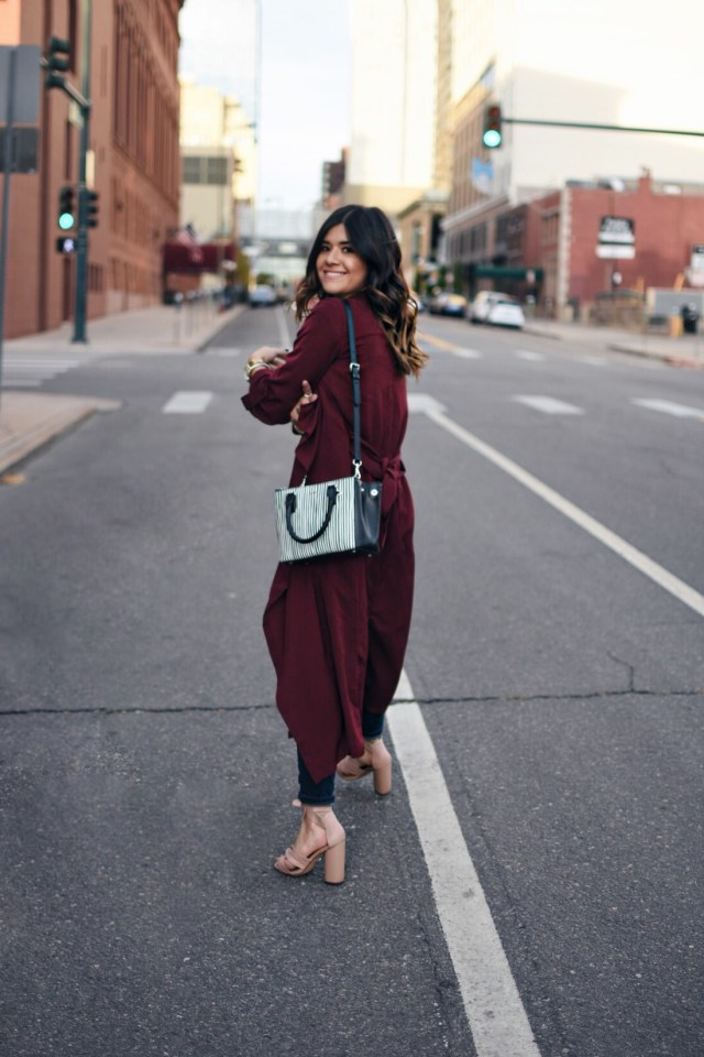 Carolina Hellal of Chic Talk wearing a Shein long burgundy cardigan, Ashley Mason skinny jeans, Topshop blush sandals, and a Ralph Lauren bag