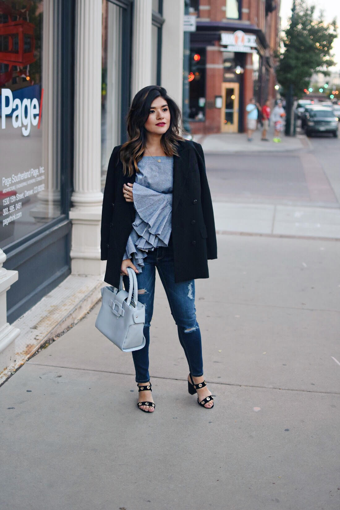 Carolina Hellal of Chic Talk wearing a Chicwish strappless top, skinny jeans, Public Desire sandals