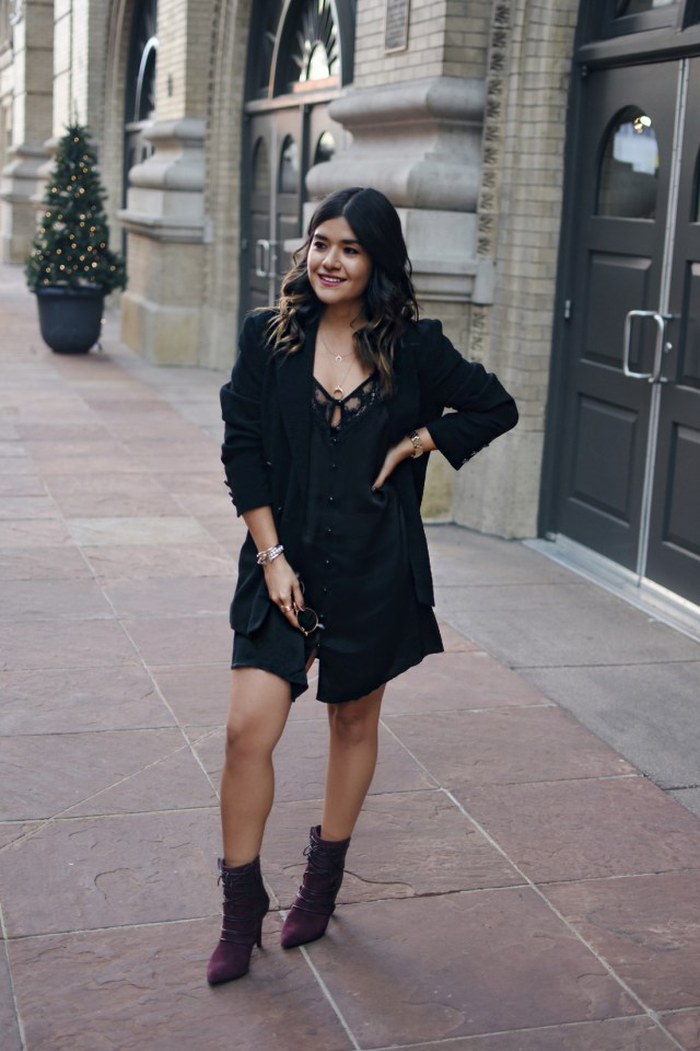 Carolina Hellal of Chic Talk wearing an American Eagle black dress, h&m black blazer, Nine West burgundy booties, and Marc Jacobs watch.