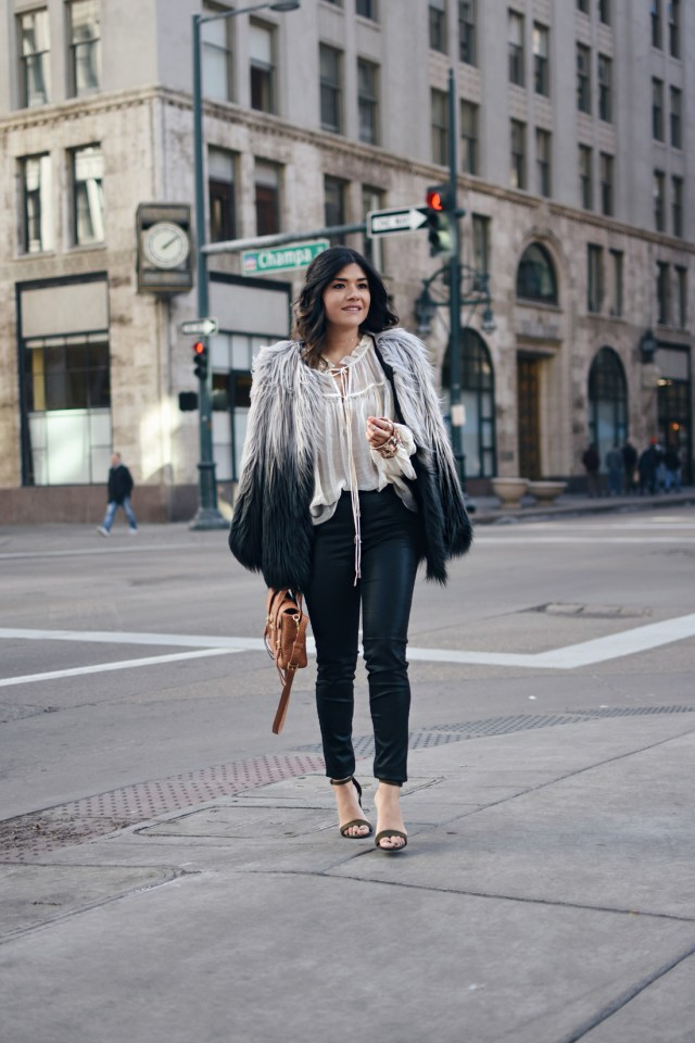 Carolina Hellal wearing a Chicwish faux fur coat, Free People sequin top, Madewell coated jeans, Payless sandals, and 3.1 Phillip Lim bag