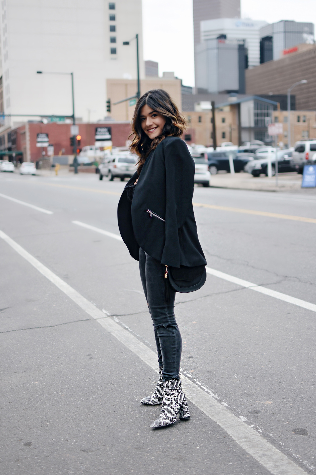 Carolina Hellal of Chic Talk wearing an Asos black lace top, Madewell jeans, Public Desire snake print boots, BCBG blazer