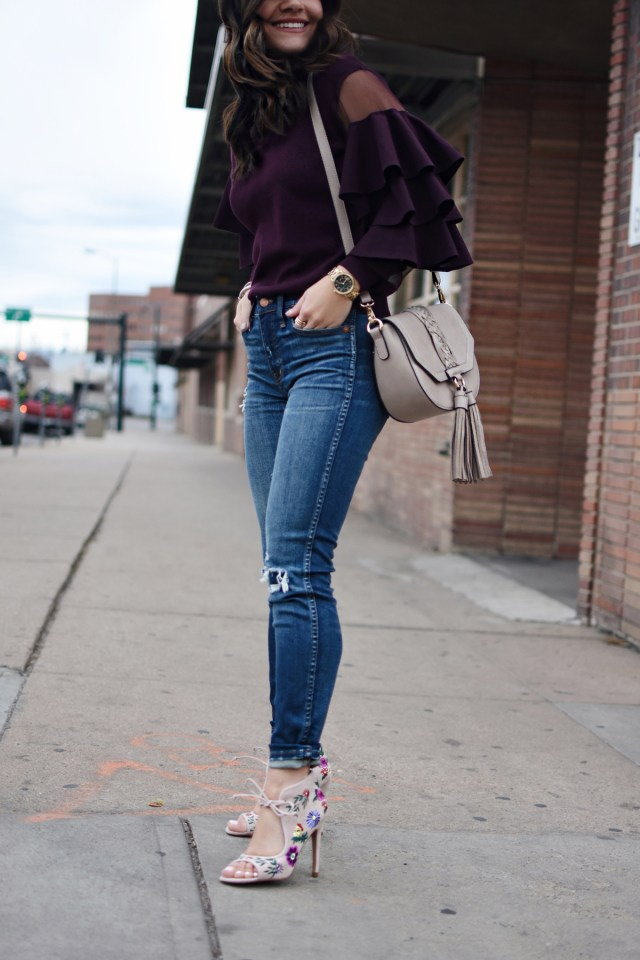 Carolina Hellal of Chic Talk wearing Madewell jeans, Betsey Johnson shoes via DSW, Chicwish ruffle top, and a Moda Luxe bag