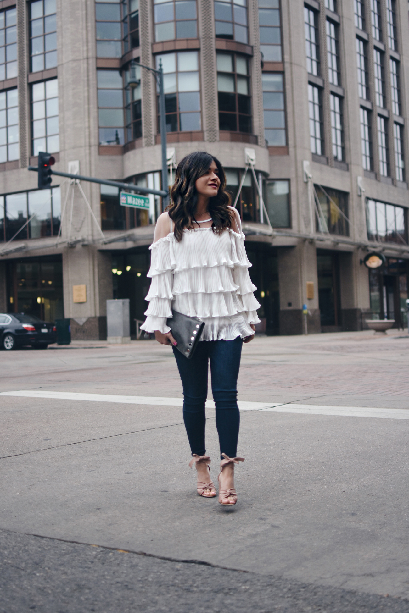 Carolina Hellal of Chic Talk wearing a Chicwish white ruffled, skinny jeans, topshop blush lace up sandals and Hammitt leather clutch