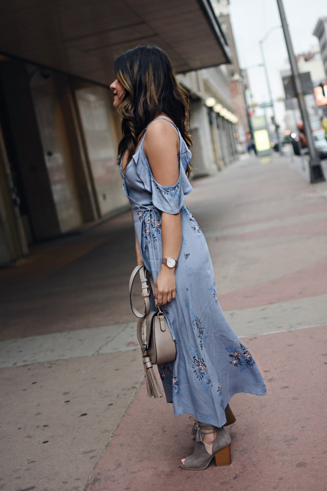 Carolina Hellal of Chic Talk wearing a midi floral dress, Moda Luxe bag and Zooshoo lace up booties