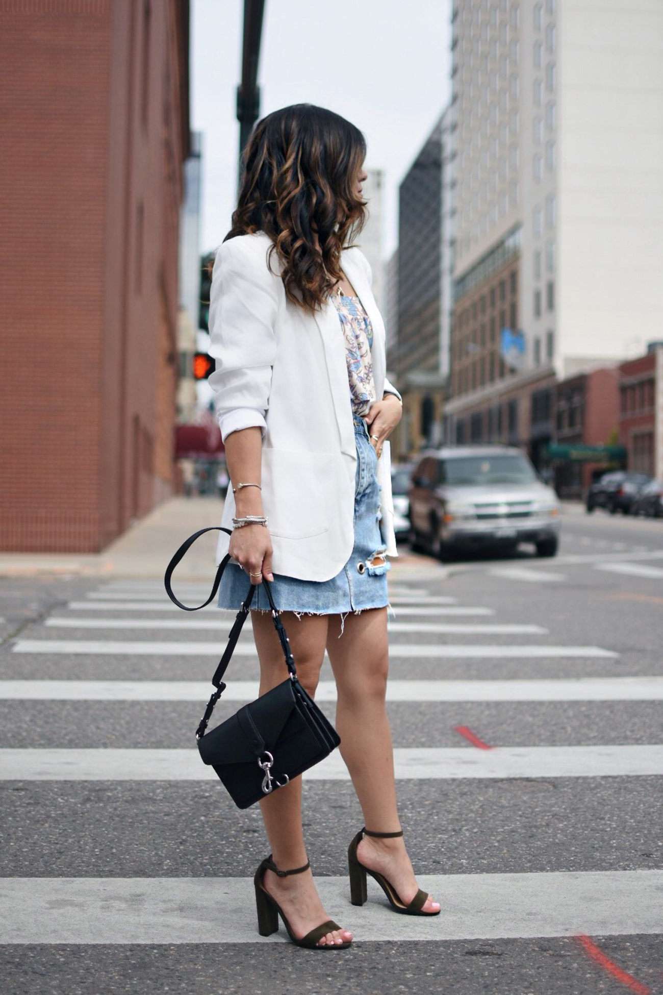 Carolina Hellal of Chic Talk wearing a Forever 21 denim mini skirt, Patterns and pops floral top, Thacker white blazer and Rebecca Minkoff black bag.