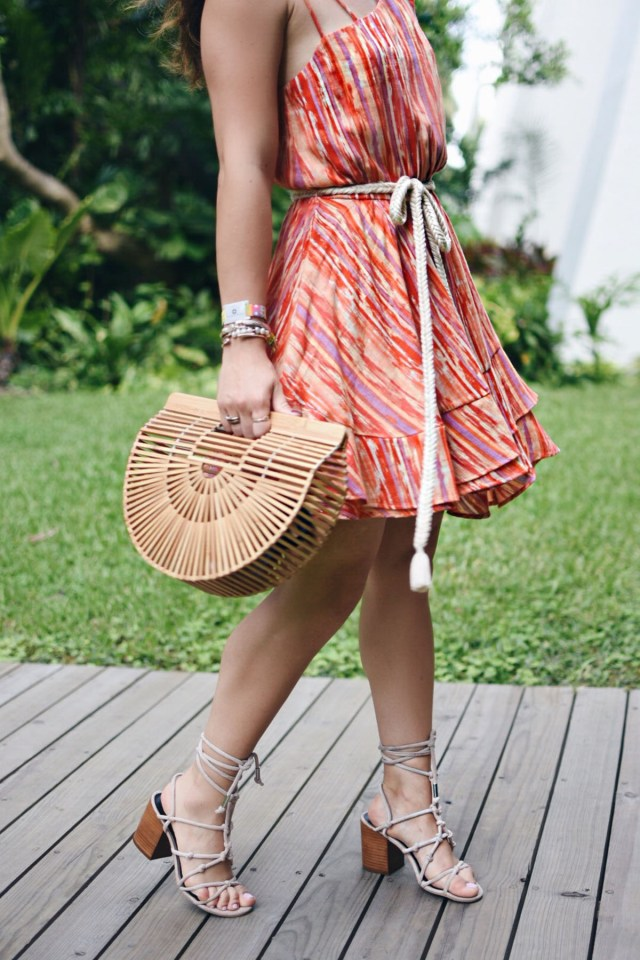 Carolina Hellal of Chic Talk wearing a Free People mini dress, Cultagaia ark bag , Rebecca Minkoff lace up sandals and Rayban sunglasses in Mexico.