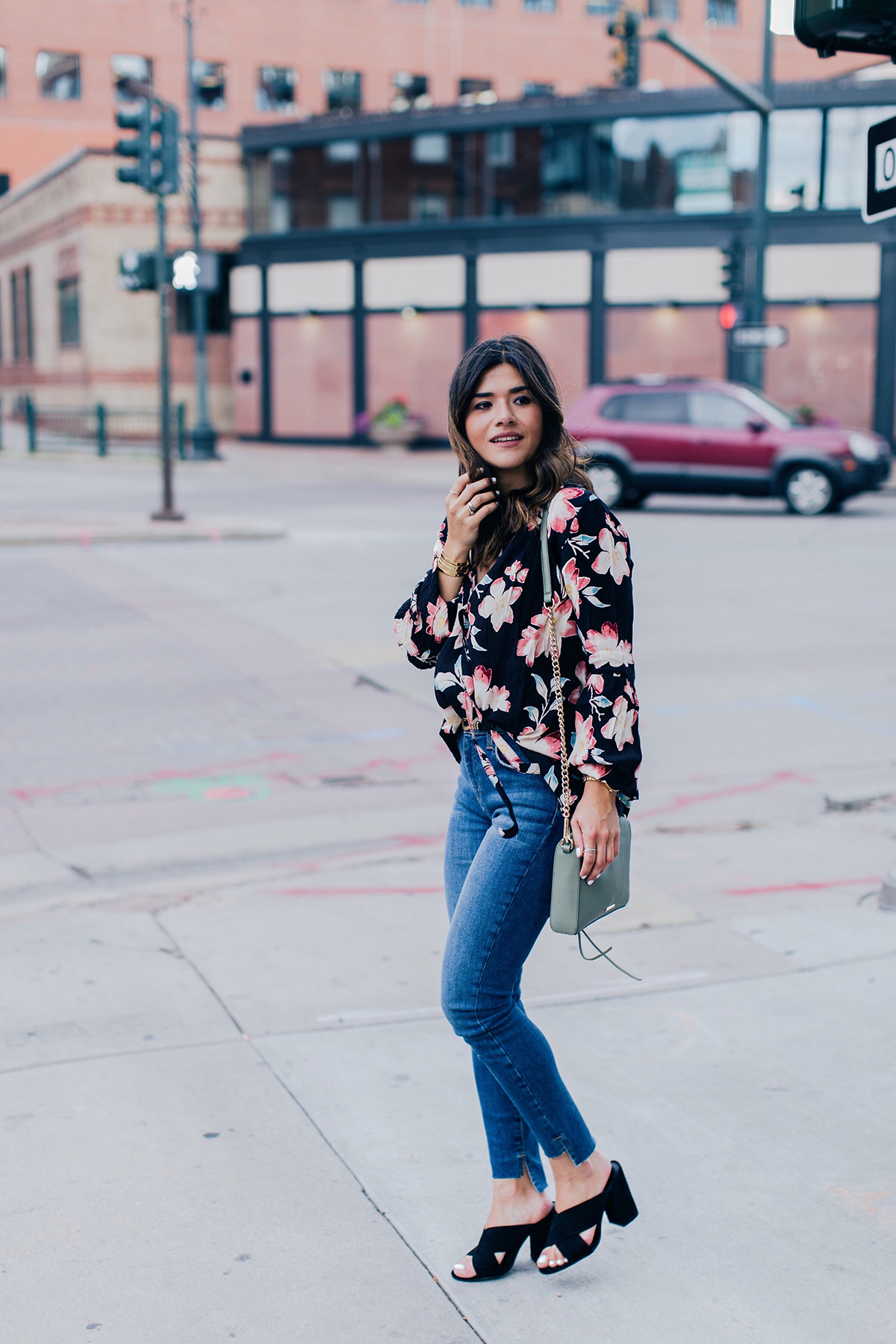 Carolina Hellal of Chic Talk wearing a floral top and Current Elliot jeans from the Nordstrom Anniversary Sale 2017
