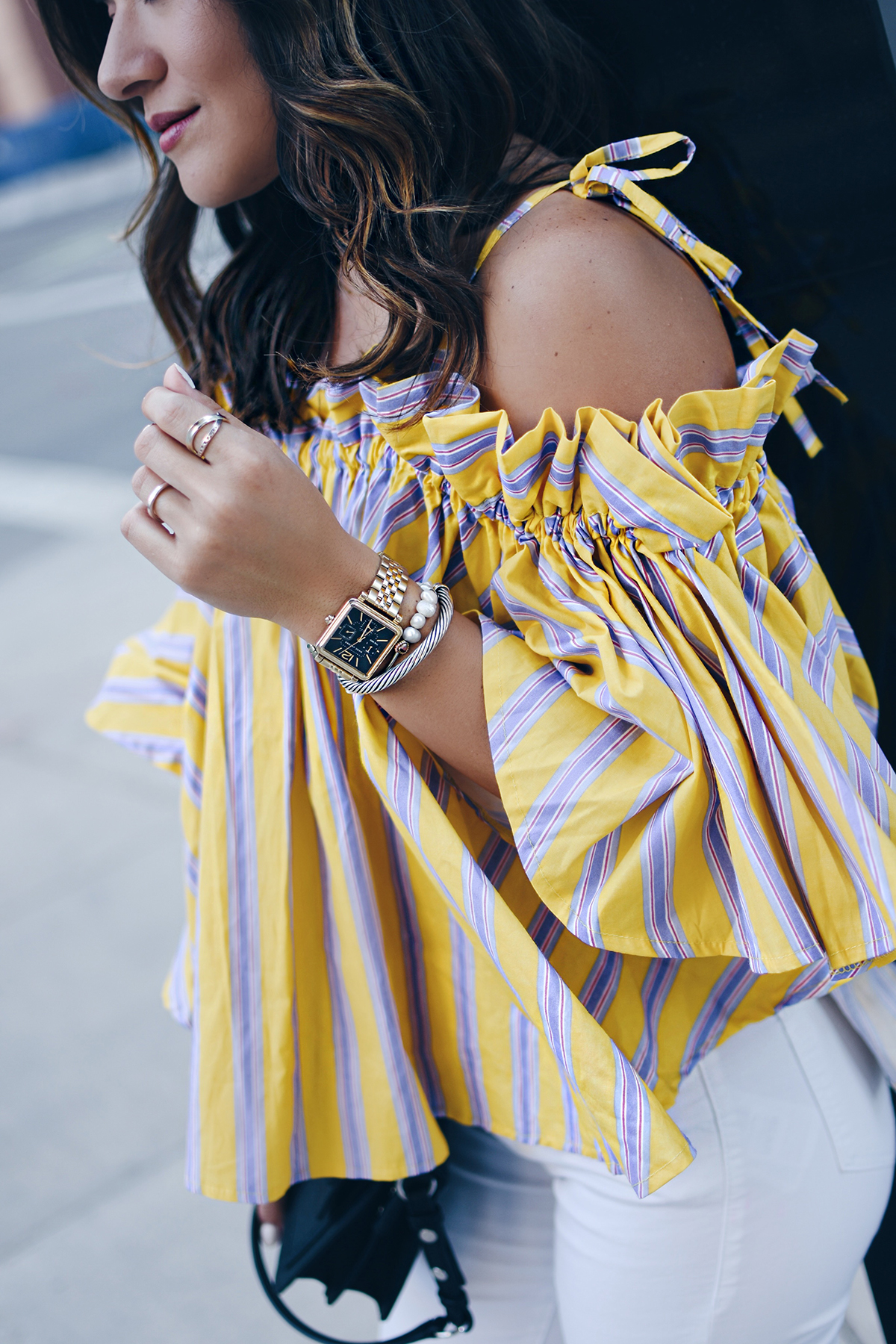 Carolina Hellal of Chic Talk wearing an off the shoulder yellow top via Chicwish, Topshop white jeans and Marc Fisher black slides
