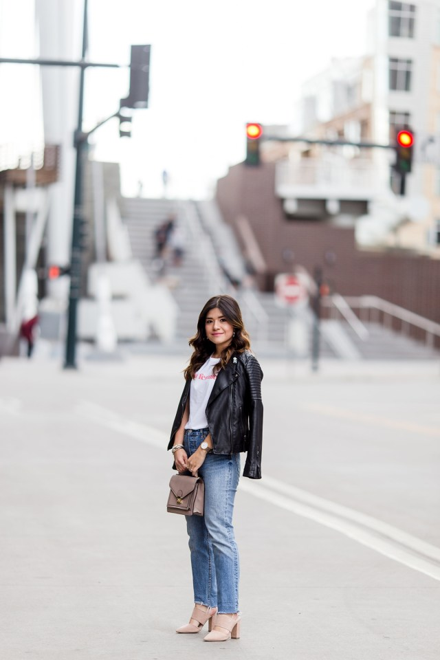 Carolina Hellal of Chic Talk wearing la femme t-shirt via Sezane, Levi's 501 straight vintage jeans, nude mules and topshop black faux leather jacket