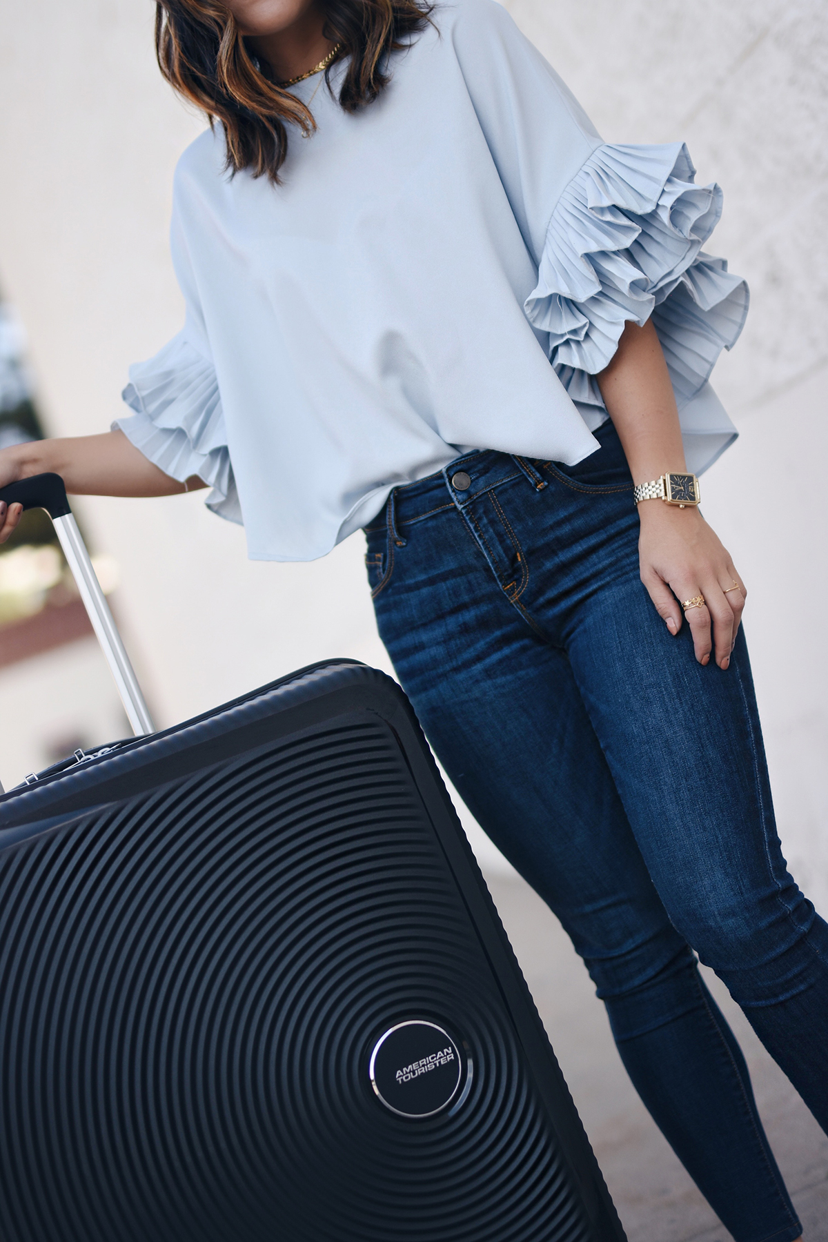 Carolina Hellal of Chic Talk with the American Tourister Curio bag in black.