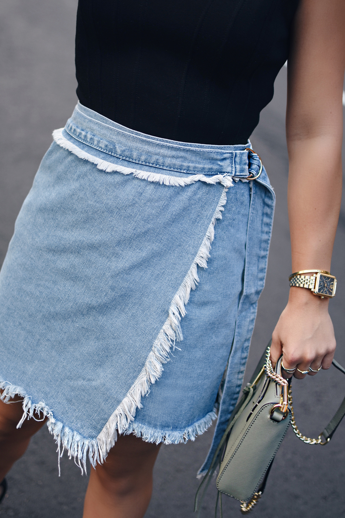 Carolina Hellal of Chic Talk wearing a shein denim skirt, Marc Fisher lace up heels, Bailey44 black top and Rebecca Minkoff bag