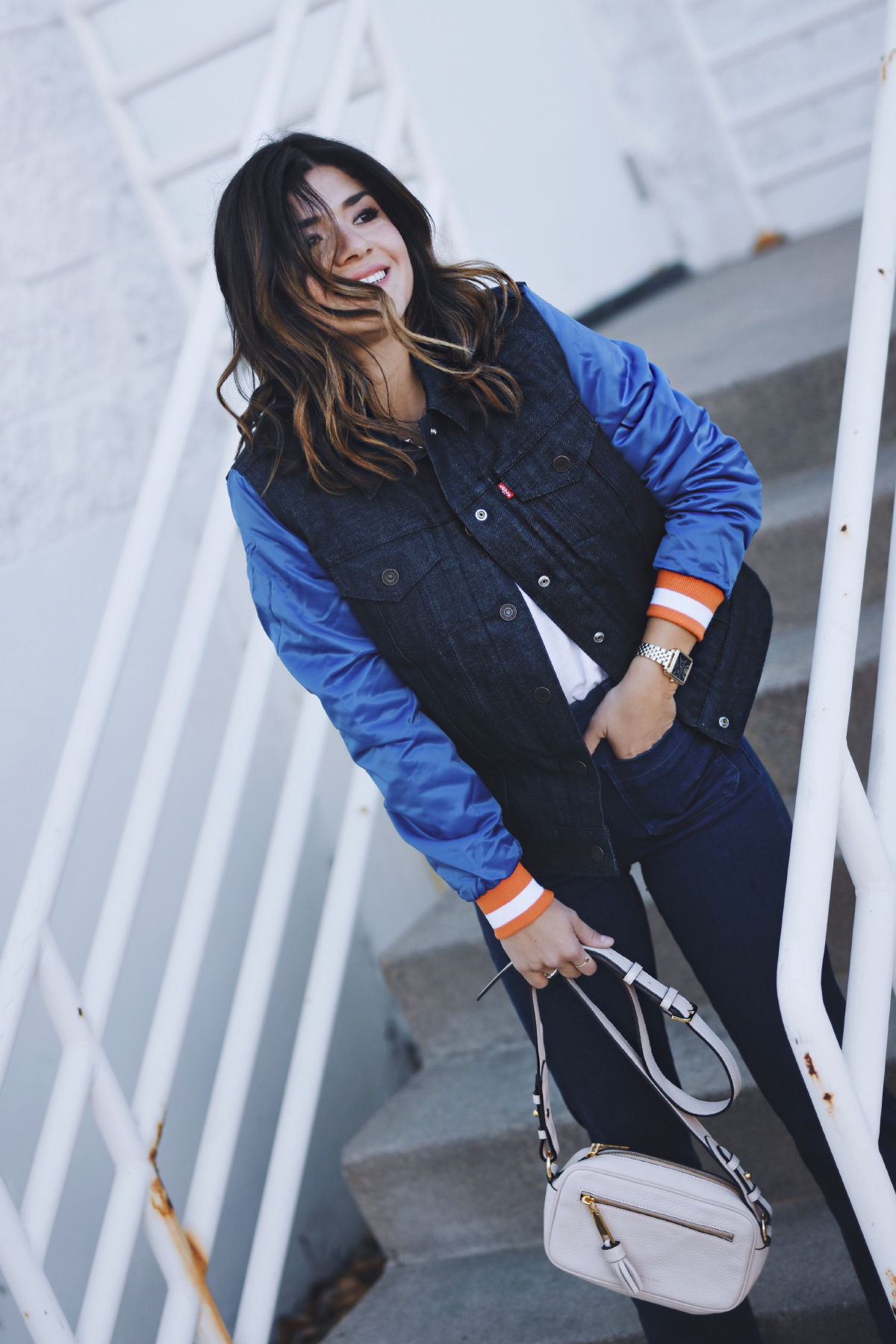 Carolina Hellal of Chic Talk wearing a Levi's Denver Broncos denim varsity jacket, Wrangler jeans and Marc Jacobs crossbody bag.