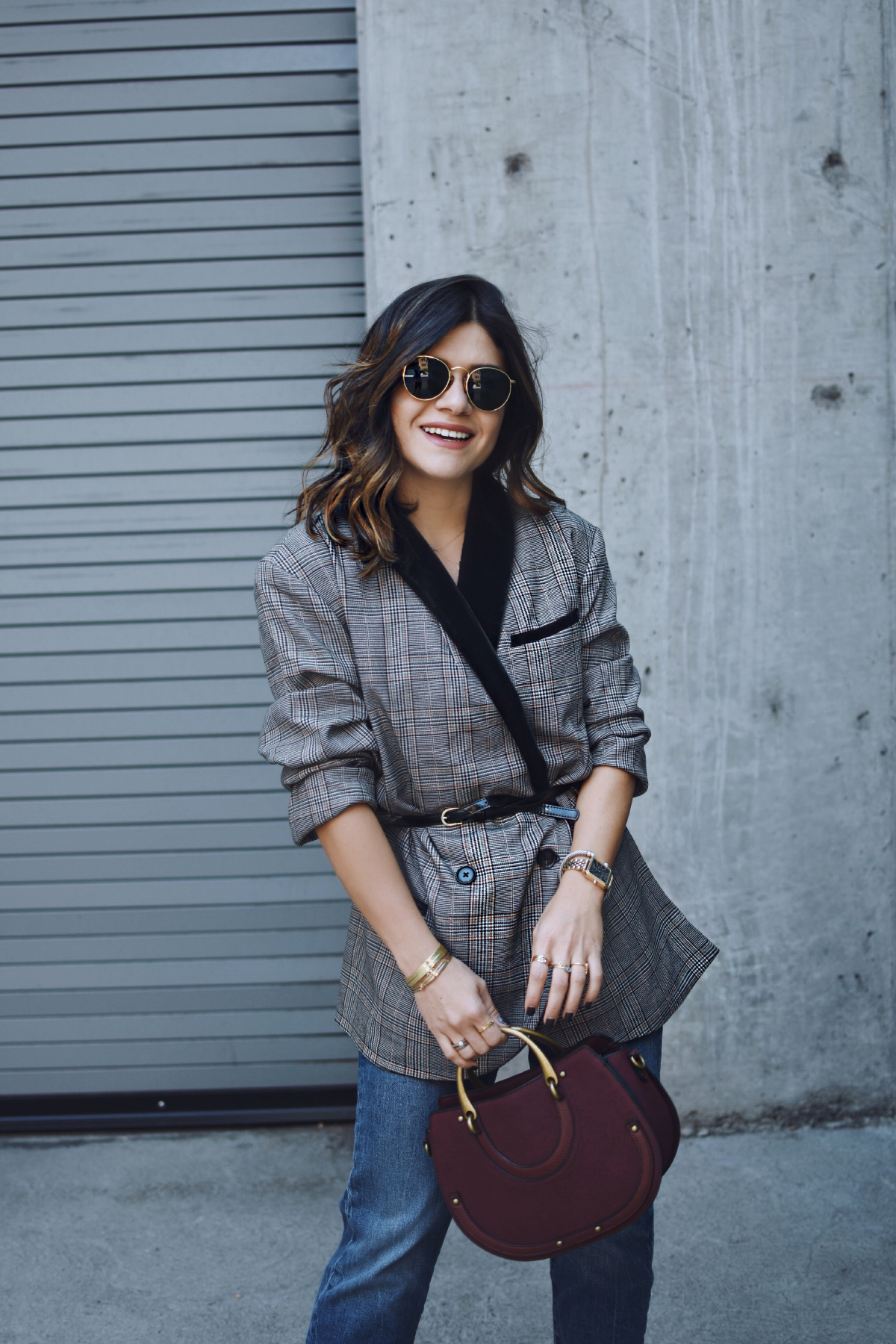 Carolina Hellal of Chic Talk wearing a Free people plaid blazer, Levi's straight jeans and charming charlie bag