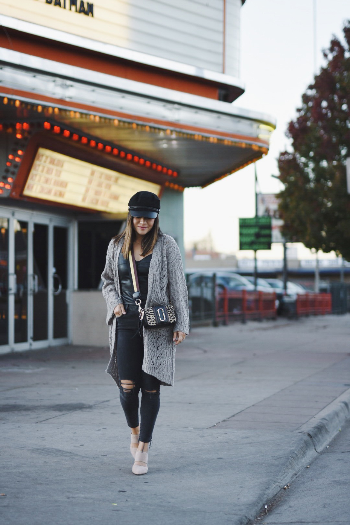 Carolina Hellal of Chic Talk wearing an h&m fisherman cap, Marc jacobs crossbody bag, madewell jeans, chicwish cardigan and nude mules