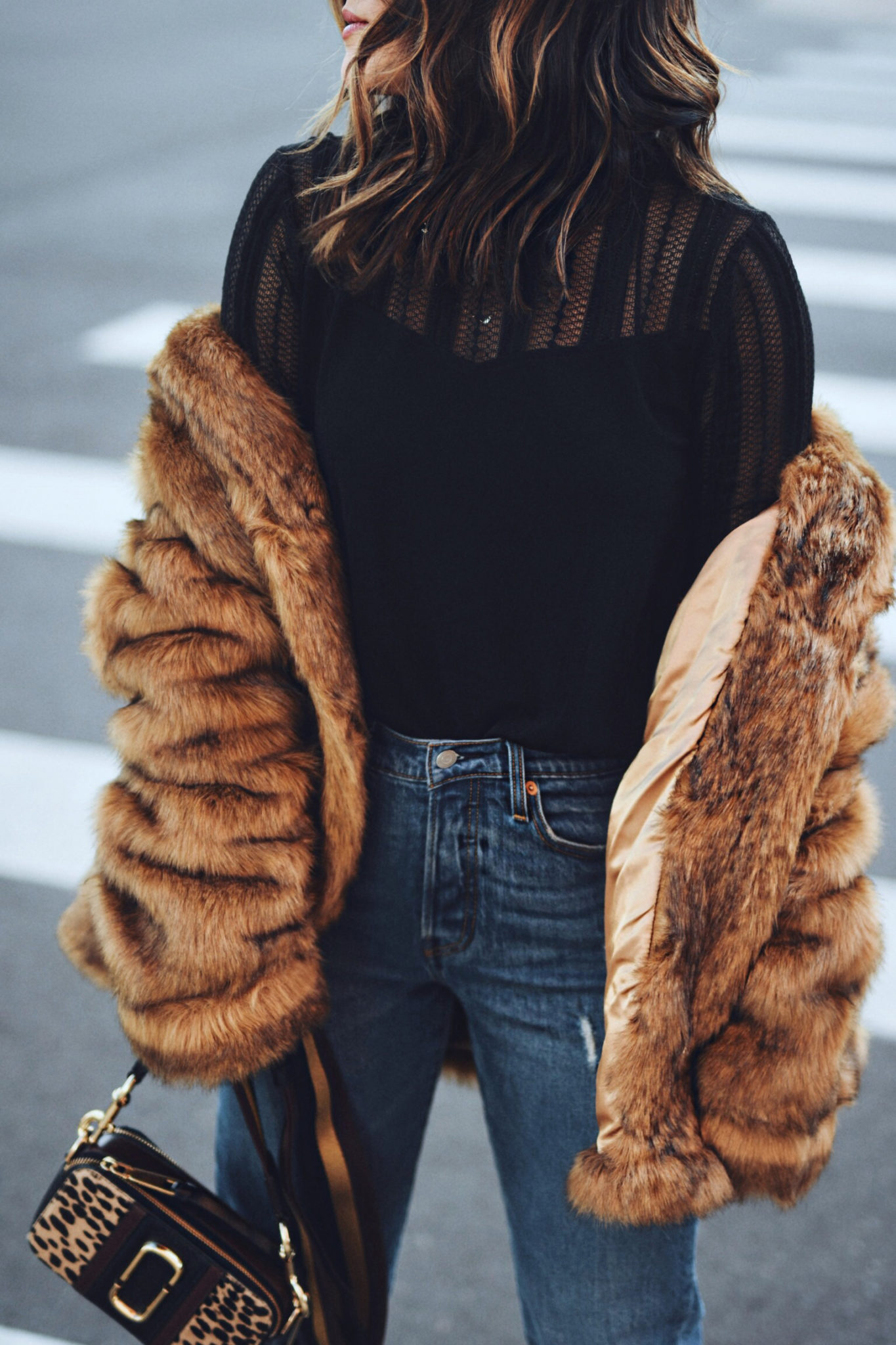 Carolina Hellal of Chic Talk wearing a faux fur coat via ASOS, Levi's jeans, Marc Jacobs crossbody bag and Nine West high heels.