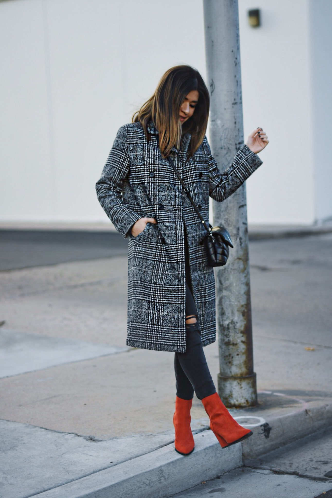 Carolina Hellal of Chic Talk wearing a Shein check print coat, River Island red boots, Madewell jeans and YSL crossbody bag.