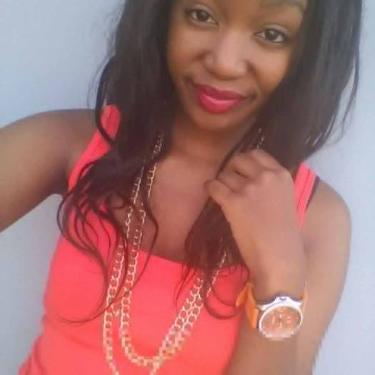 African Teenage Girl Wearing an Olatz Chain Necklace