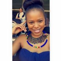 South African Lady with Chic African Necklace and Bun Knot Hairstyle