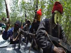 Militants beheads three persons, burn houses in overnight attacks