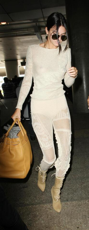 Wow! Braless Kendall Jenner flashes her bum in see-through tracksuit after arriving in France