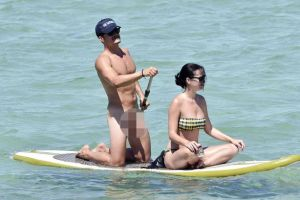 Katy Perry finally reveals why she looks SO MISERABLE in those Orlando Bloom naked paddle boarding pictures