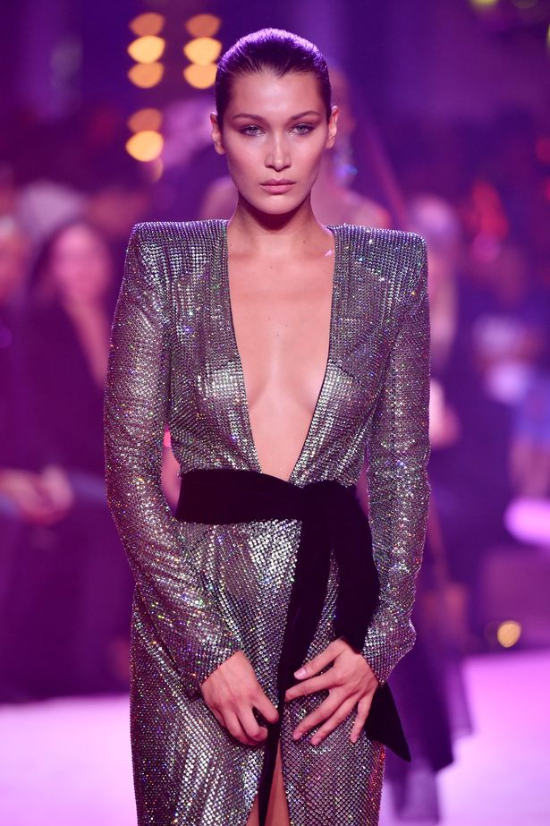 Bella Hadid struts her stuff on the catwalk in sheer nipple-baring design before slipping into sexy silver number