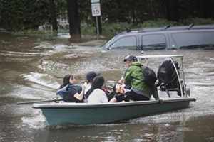 Volunteers and officers from the neighborhood security patrol help to rescue residents in the upscale River Oaks neighborhood after it was inundated with flooding from Hurricane Harvey in Houston, Texas.
