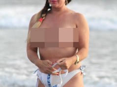 Lisa Appleton risks jail by going topless on the beach