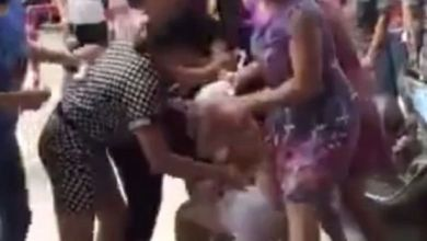 Mob of angry wives strip 'mistress' in street after she was caught 'red-handed'