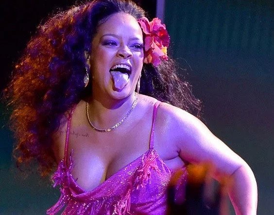Photo of Busty Rihanna almost falls out of her frock while gyrating at the Grammys (Photos/Video)