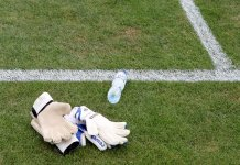 Football fan caught urinating in goalkeeper's water bottle - Watch Video