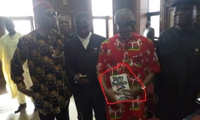 Senator Enyinnaya Abaribe appears in court holding a book called 'Dirty politics'