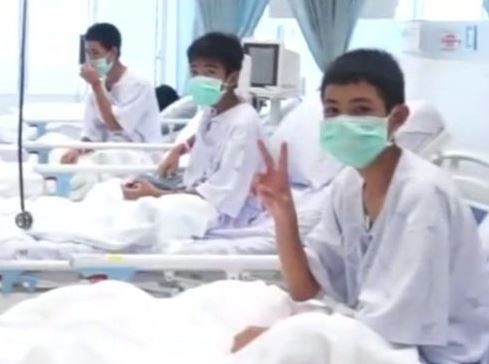 First pictures of the rescued Thailand boys and their coach at the hospital