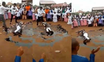 Drama as pastor rolls in engine oil while members spray money on him during crusade (video)