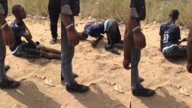 Nigerian man high on drugs walks with his head on the ground (Watch Video)