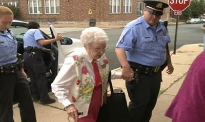 Police cuff and arrest 102 year old woman 1