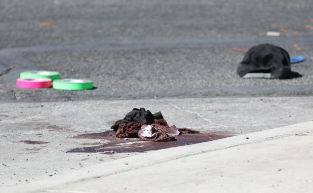 Blood-stained clothing lies near the festival (Image: REX/Shutterstock)
