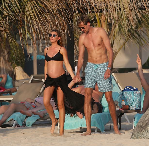 Abbey Clancy shows off a beach bump as pregnant supermodel enjoys break in the sun with Peter Crouch