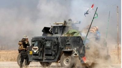 An Iraqi special forces soldier fires a cannon at Islamic States fighters in Bartella, east of Mosul, Iraq on 20 October 2016.