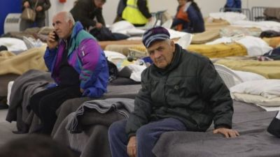Locals in Italy prepare to spend the night in a warehouse after a powerful earthquake hit