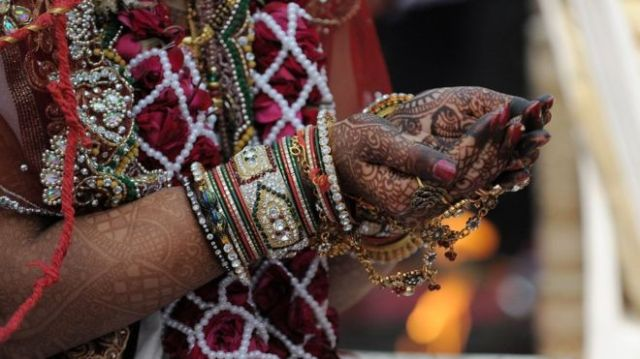 A Hindu Jain bride in a mass wedding ceremony at the Karnawati Club in Ahmedabad on February 2, 2014