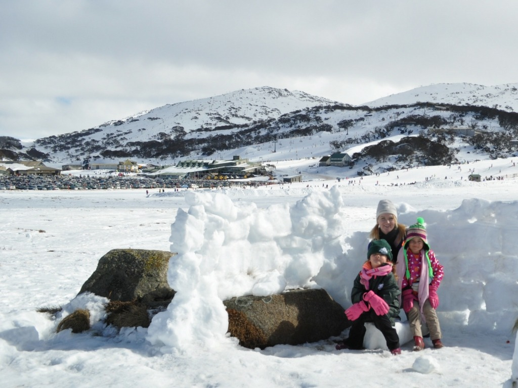 Kylie Travers with her daughters at the snow.