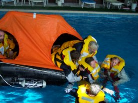 Life raft training in the pool as part of STCW Basic Safety