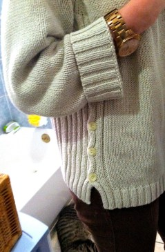 I really enjoy the buttons and ribbing on the side of this sweater.