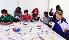 Children with CFL team writing messages