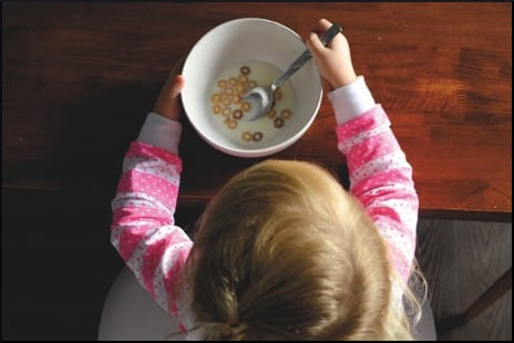 kid-eating-cereal-from-above