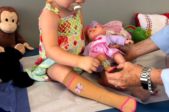 How a compression sock on my child's doll helped her cope